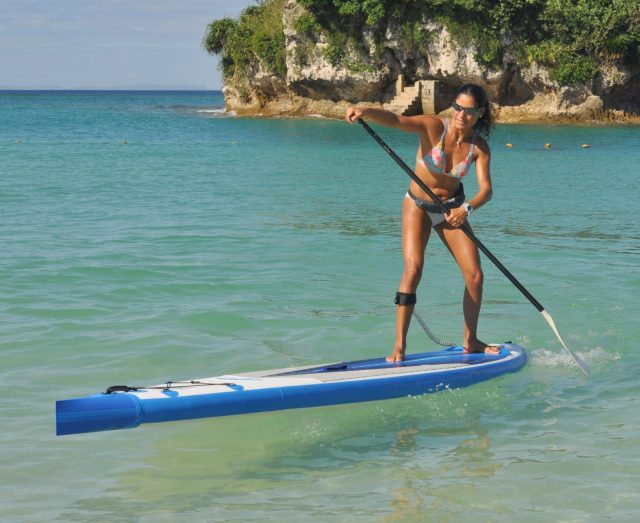"""This is the energetic lady we were making the new 26"""" wide NeedleNose SUP for. In this picture she is pivoting on our standard Sea Eagle NeedleNose."""